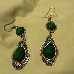 Women's dangling emerald earrings. Costume jewelry